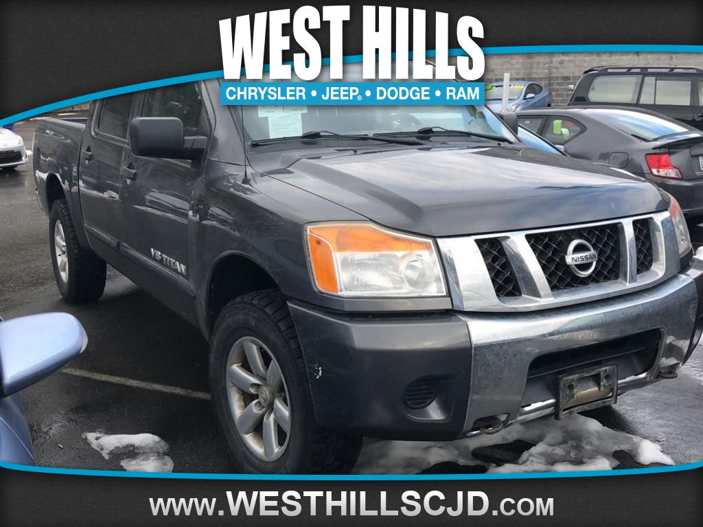 Pre Owned 2011 Nissan Titan Sv 4wd Crew Cab Swb In Bremerton Et7263